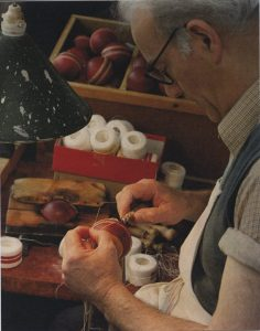 Jos Burchetts add 80 stitches to the outer cover of a cricket ball at the Wisden Factory in Chiddingstone Causeway, 1970, © Eden Valley Museum Trust