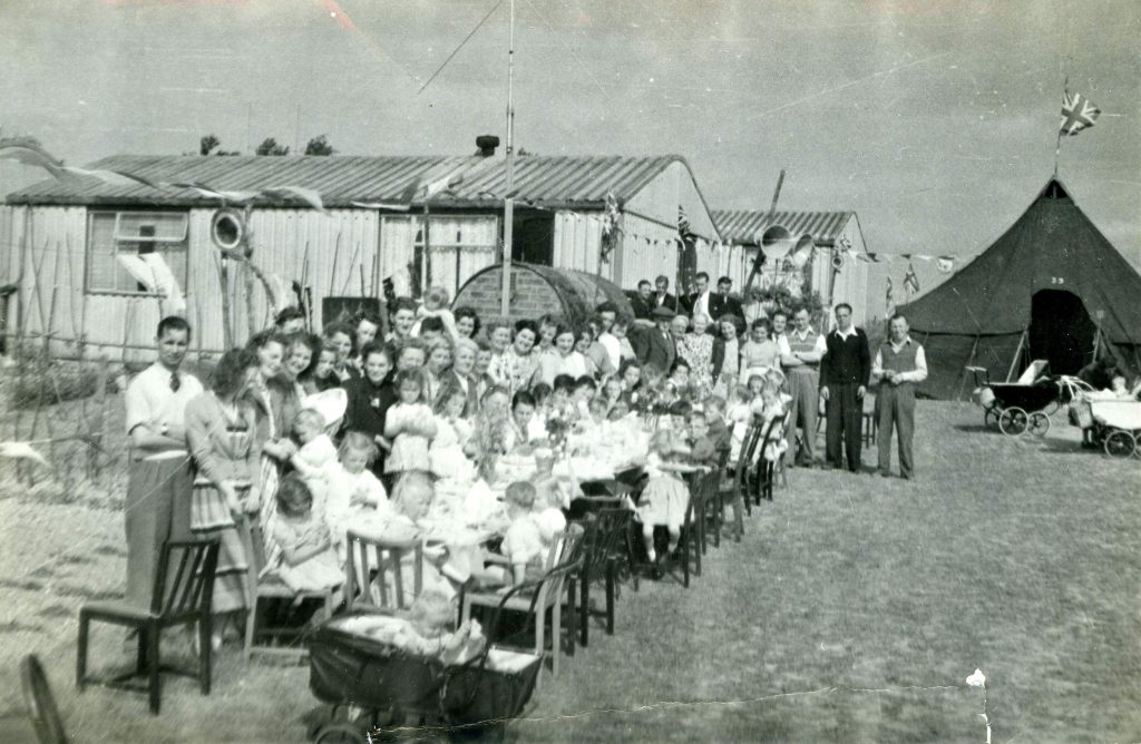Coronation party outside temporary prefabs on Dynes Road, Kemsing, 1953. Courtesy of Ed Thompson, Otford Historical Society.