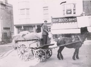 Boots chemists in Sevenoaks with horse and cart in front